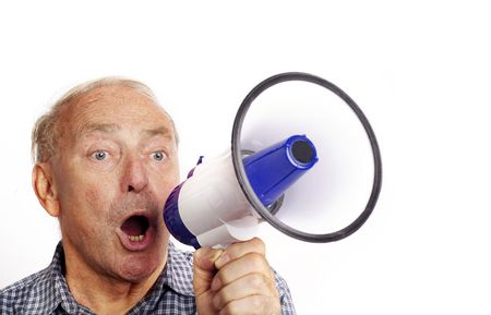 A mature man shouting through a bull horn isolated against white background.  photo