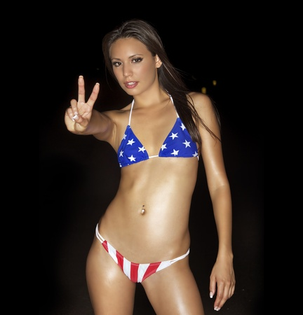 Sexy peace sign bikini girl photo
