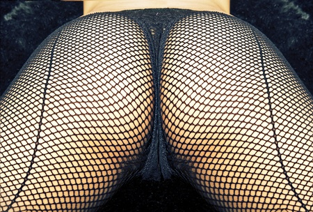 Sexy ass in fish net thong stocking underwear Stock Photo - 10159875