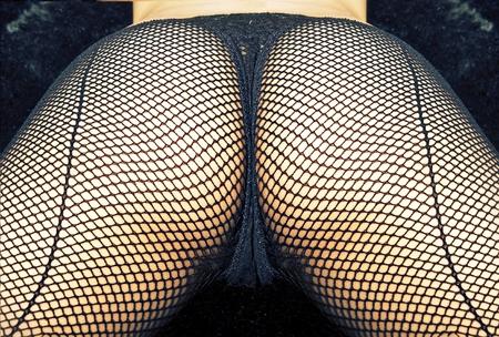 Sexy ass in fish net thong stocking underwear Stock Photo - 10159875