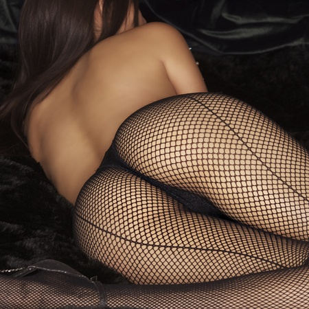 Beautiful woman wearing fishnet stockings  Stock Photo - 10204496