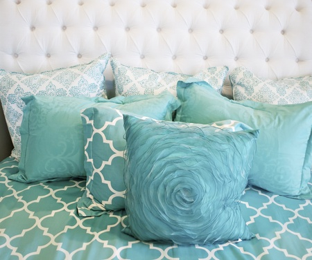 bedspread: Teal bedding Stock Photo