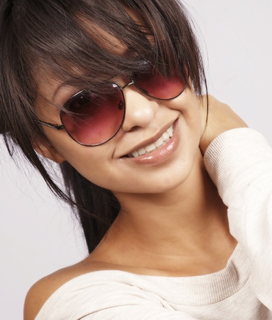 pics: Pretty young woman wearing sunglasses Stock Photo
