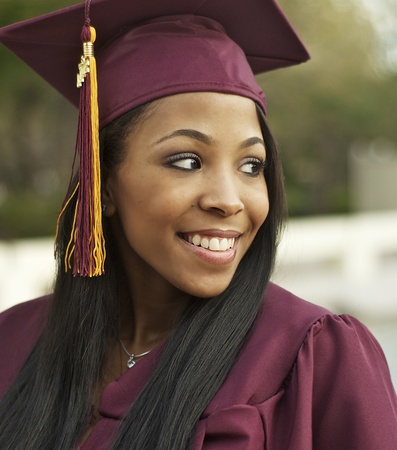 occupation: african american, attractive, beauty, career, celebrate, close up, college student, content, education, face, female, friendly, girl, graduation, graduation cap, happy, outdoor, people, photo, picture, portrait, purple, satisfied, school, smile, successfu Stock Photo