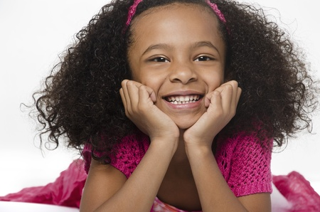 Adorable smiling little girl with curly hair photo