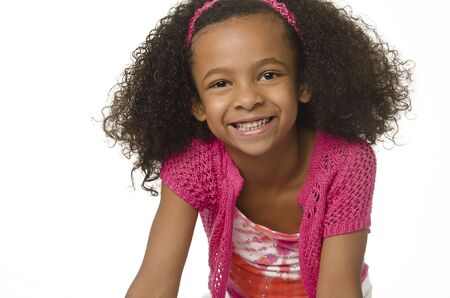 Adorable smiling little girl with curly hair Stock Photo - 12405726