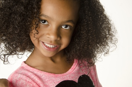 afro curly hair: Adorable smiling little girl with curly hair