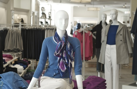 outlet: Ladies fashion boutique store and mannequins Stock Photo