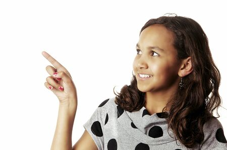finger teen: Pretty girl pointing hand finger up to side Stock Photo