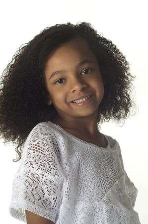 Adorable smiling little girl with curly hair Stock Photo - 12405741