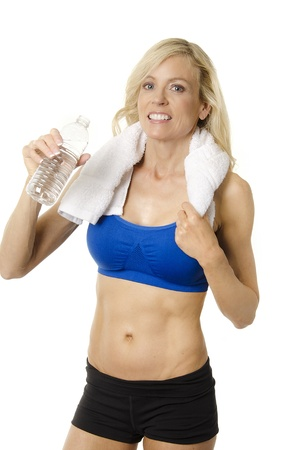 Happy fit healthy toned woman drinking water after tough workout   photo