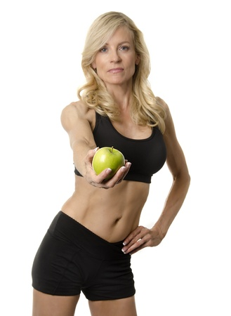 Active healthy fitness woman holding apple  photo
