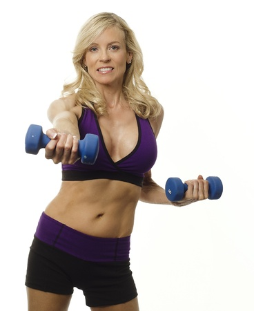 Attractive woman maintaing weight and vitality by exercising photo