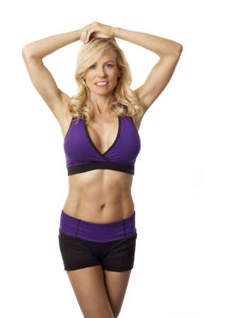 Attractive woman maintaing weight and vitality by exercising Stock Photo - 12614087