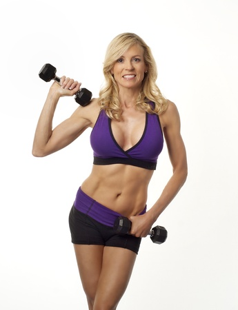 heavy weight: Attractive woman maintaing weight and vitality by exercising
