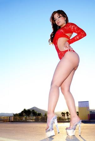 eroticism: Beautiful long legged exotic young woman