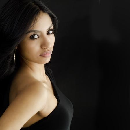 beautiful brunette: Beautiful exotic young woman on white background Stock Photo