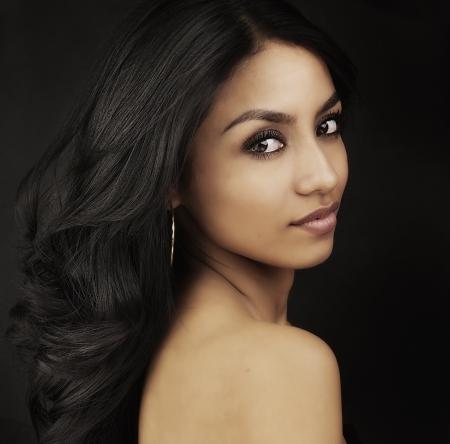 shiny black: Beautiful exotic young woman