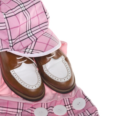 Ladies golf shoes and pink plaid clothing