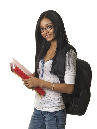 Smiling student holding books photo