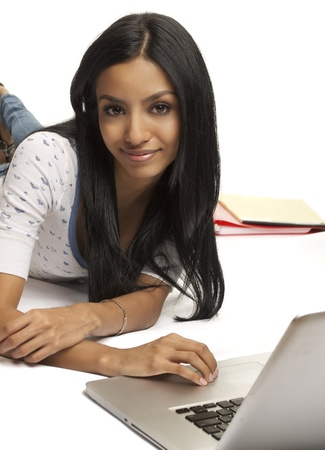 Smiling, happy, positive, attractive young woman working on her laptop computer