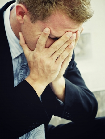 Sad angry depressed man in business suit Stock Photo - 15044922