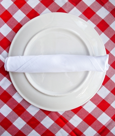 Red and white tablecloth with plate                              photo