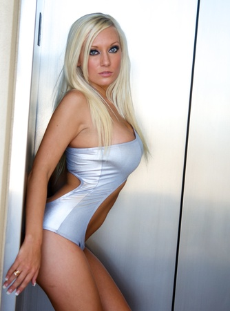 Beautiful young sexy woman posing glamor style