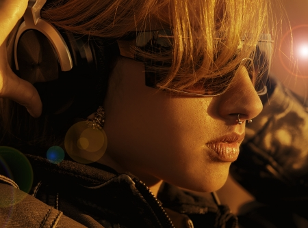 DJ Music girl looking out to the sunset wearing headphones photo