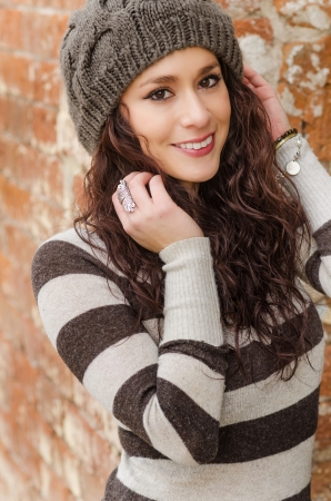 Beautiful young brunette woman with smile wool hat photo