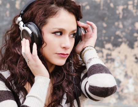 Young happy woman listening to music headphones photo