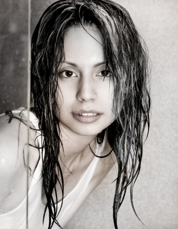 wet t shirt: Impish cute young beautiful face of young woman