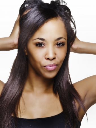 african american woman: Beautiful African American young woman isolated against white background   Stock Photo