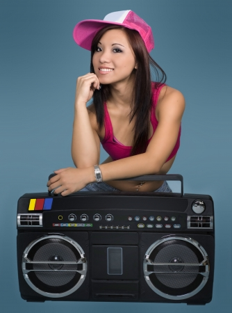 rapping: Beautiful smiling woman with retro boombox