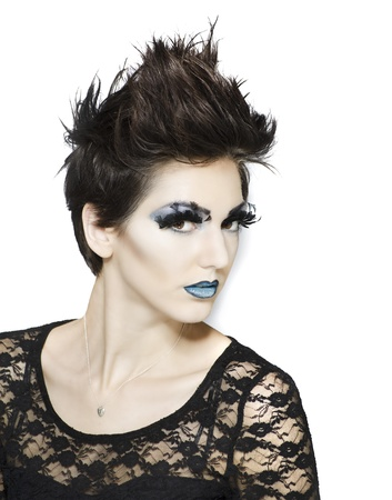 Beautiful fashion model with short hair and wild makeup photo