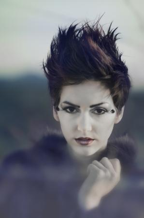 Beautiful fashion model with short stylish hair. 免版税图像