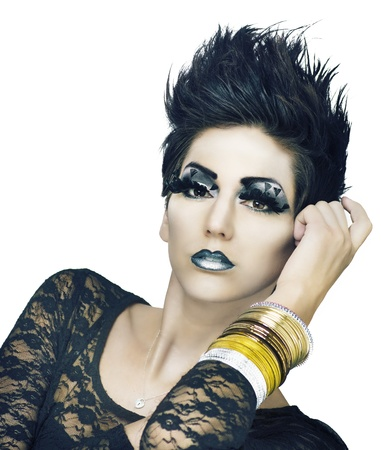Fashion model - Beautiful young woman with stylish short hair and wild creative makeup  photo