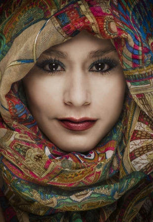 materia: Exotic woman wearing colorful head scarf  Stock Photo