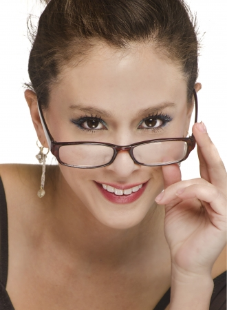 Beautiful smiling woman wearing reading glasses photo