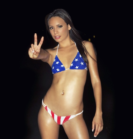 Youth culture sexy party time  Beautiful young woman wearing USA tiny bikini outdoor beach at summer rave party event