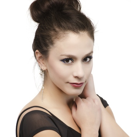 Beautiful young woman s face with hair in bun  photo