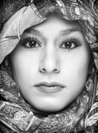 Beautiful young woman wearing head scarf  photo