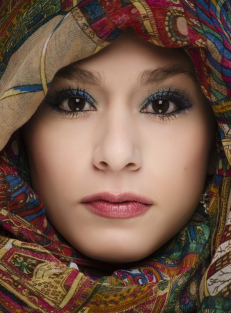 Beautiful young woman wearing head scarf  photo