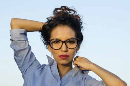 Beautiful woman wearing eye glasses specs Stock Photo