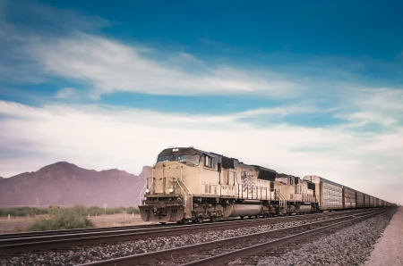 Freight train running travelling Arizona desert photo
