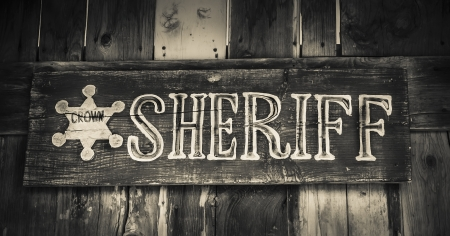western usa: Sheriff sign on wooden sign in cowboy town