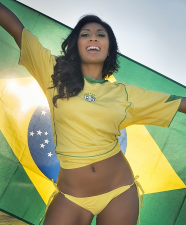 brazil country: Beautiful smiling happy Brazil football fan