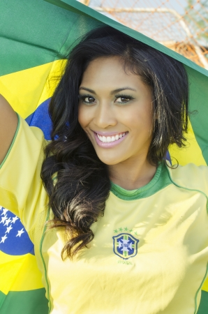 thong woman: Beautiful smiling happy Brazil football fan