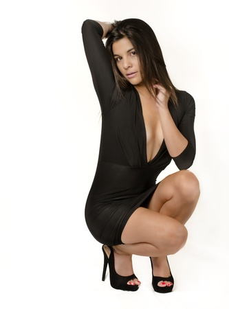Beautiful young woman wearing black dress photo