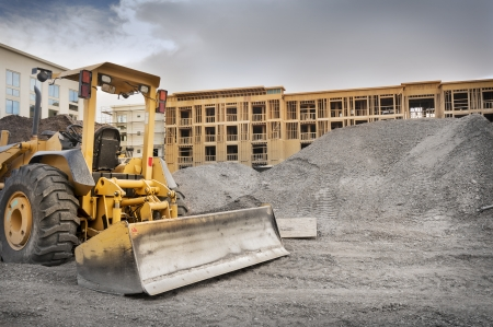 commercial real estate: Industrial bull dozer on construction site